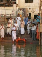 chanting prayers on the ganges