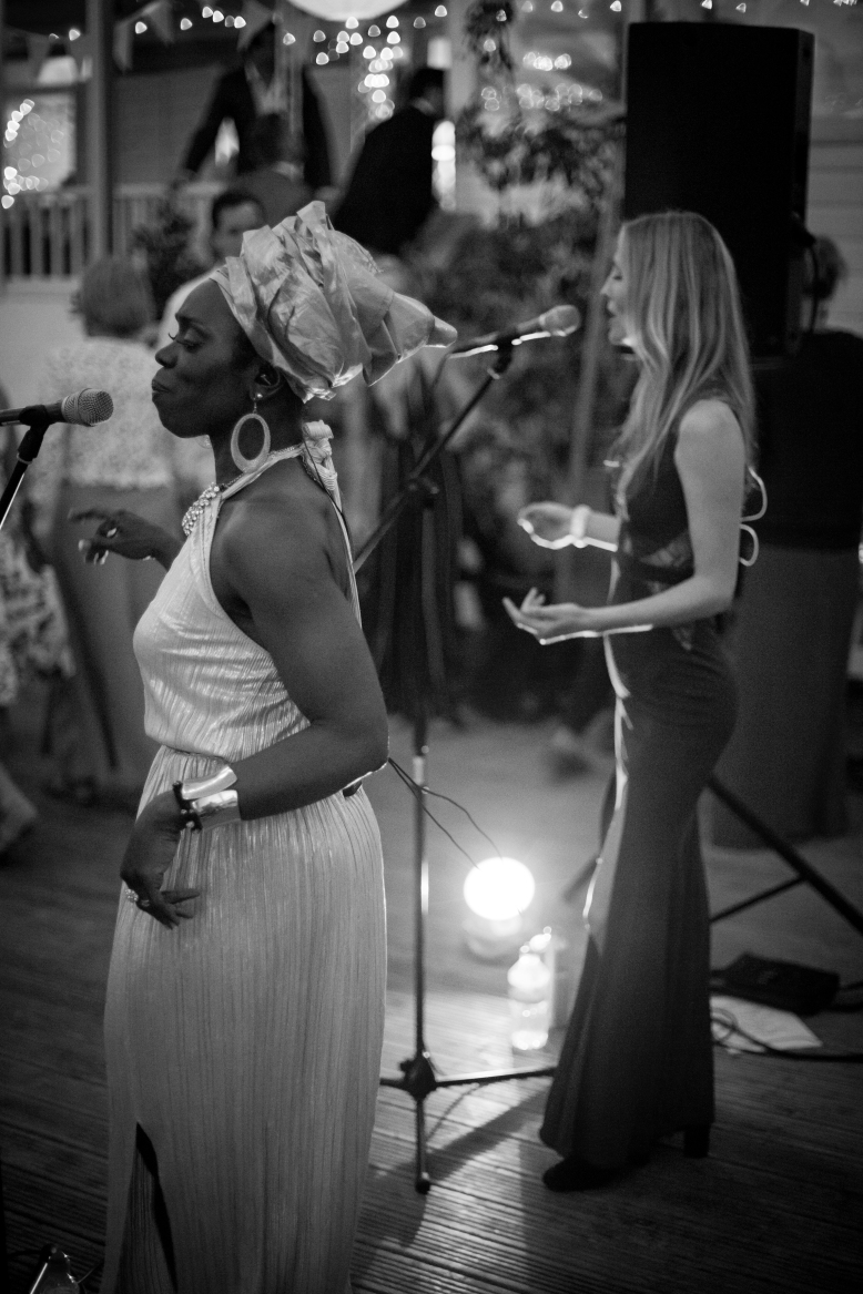 Janice M singing with Ley Adewole, lead vocalist, in The Grace Notes, Private Party, Devoran, Cornwall 2015